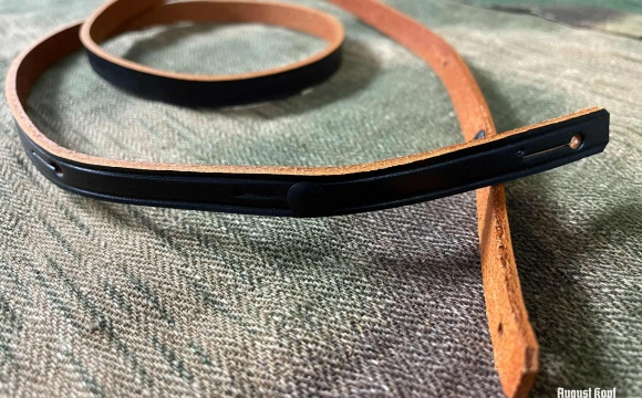 Replacement binocular sling with two pins (one on each side).