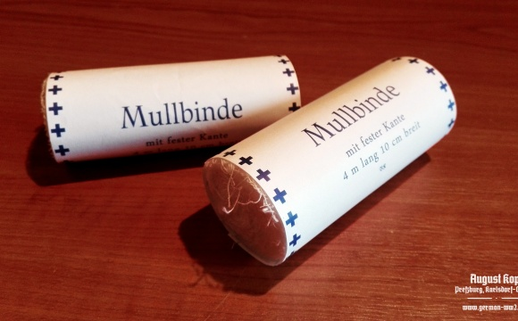 Simple medical bandage, rolled in paper wrapper with printed information: 4m length, 10cm width.
