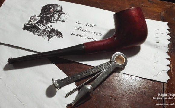 A new pipe made of nice pie-cherry wood, chosen to represent a commonly available pipe used during WW2.