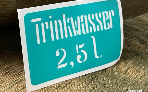 Plastic sticker stencil for popular Trinkwasser canisters.