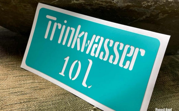 Plastic sticker stencil for less common Trinkwasser canisters.
